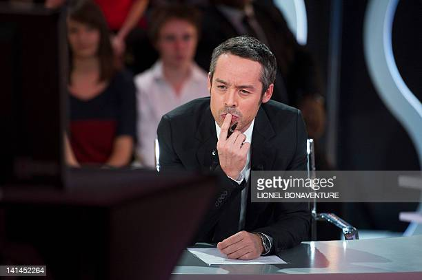 French TV host Yann Barthès is pictured as he interviews France's incumbent President and UMP ruling candidate for 2012 presidential election as part...
