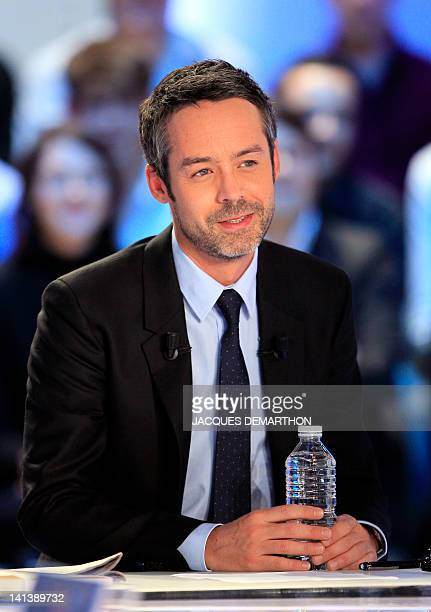 French TV host Yann Barthès is pictured prior to takes part in his TV show 'Le petit journal' on a set of French TV Canal on March 15 2012 in Paris...