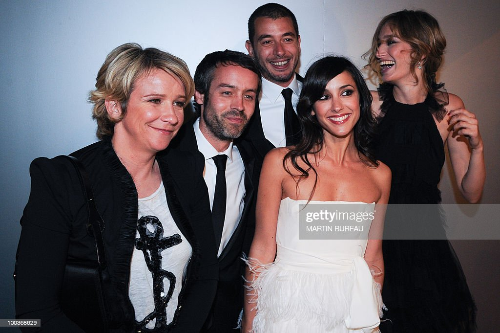 French TV hosts Ariane Massenet, Yann Barthes, Ali Baddou, Elise Chassaing, and Pauline Lefevre arrive to attend the Figaro Madame/Chanel dinner during the 63rd Cannes Film Festival on May 18, 2010 in Cannes.