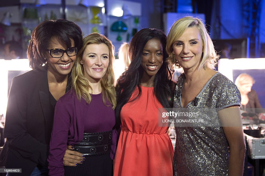 French TV hosts journalists Audrey Pulvar (L), Elisabeth Bost (2ndL), Hapsatou Sy (C) and Laurence Ferrari (2ndR) pose during the official launching of the French D8 TV channel on October 7, 2012 in Paris. D8 is the new name of Direct 8 that Canal + group bought to French Bollore group. They will host the program 'Le Grand 8'.