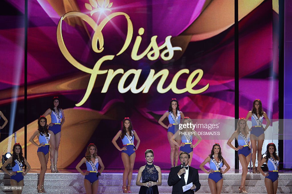 French TV presentator Jean-Pierre Foucault (R) speaks next to Miss France Society president Sylvie Tellier (L) during the 67th edition of the Miss France beauty contest in Dijon on December 7, 2012.