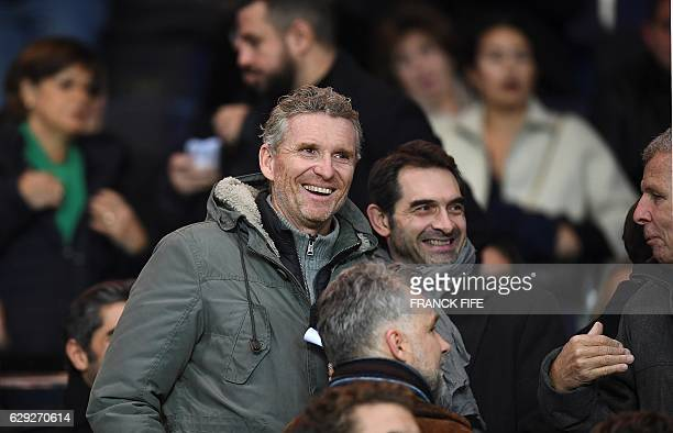 French TV presenter Denis Brogniart attends the French L1 football match between Paris SaintGermain and Nice at the Parc des Princes stadium in Paris...