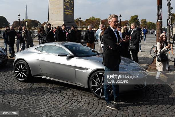 French TV presenter Denis Brogniart poses in front of the Aston Martin DB10 the James Bond's car in the next movie 'Spectre' scheduled for November...