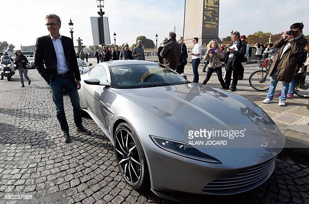 French TV presenter Denis Brogniart poses next to the Aston Martin DB10 the James Bond's car in the next movie 'Spectre' scheduled for November...