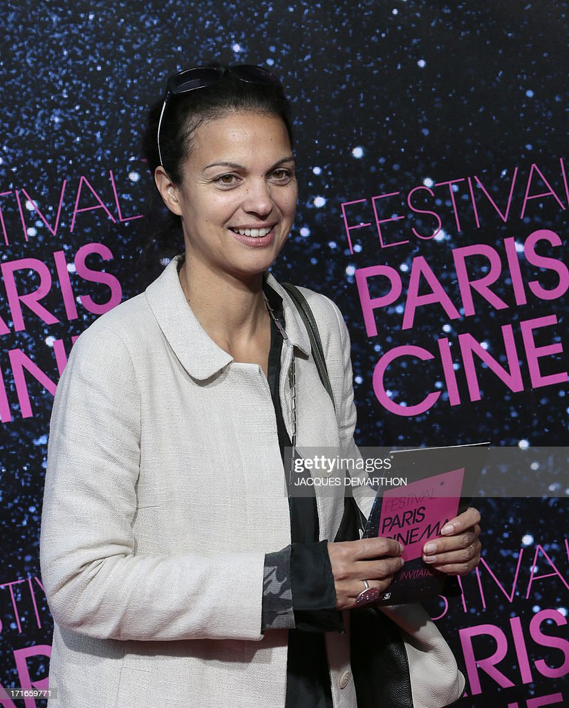 French TV presenter Isabelle Giordano poses at the photocall for the premiere of La Venus a la fourrure (Venus in Fur), during the official opening of the 11th Festival Paris Cinema in Paris on June 27, 2013. The film is the latest directed by Polish-French director Roman Polanski.