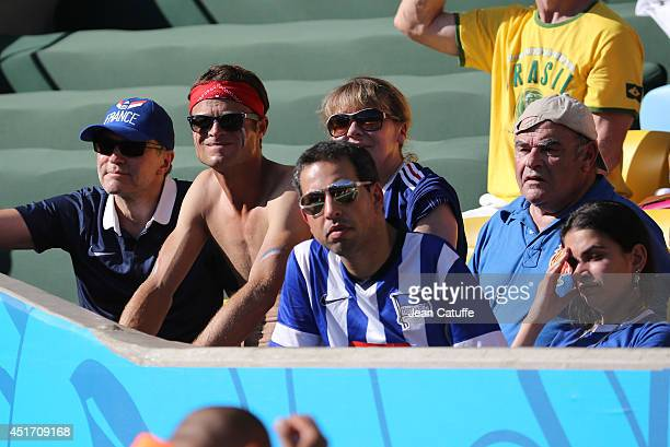 French TV presenter Laurent Ruquier and Jean Benguigui attend the 2014 FIFA World Cup Brazil Quarter Final match between France and Germany at...