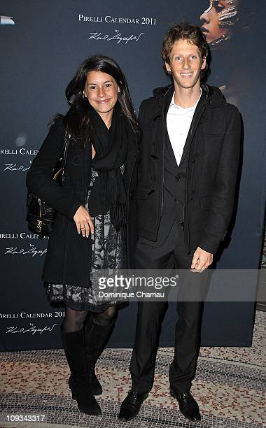 French TV presenter Marion Jolles and Romain Grosjean attend the Pirelli 2011 Calendar lauch at Le Mini Palais on January 13 2011 in Paris France
