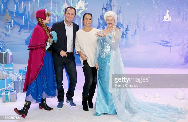 French TV presenters JeanPhilippe Doux and Faustine Bollaert attend the Christmas season launch at Disneyland Paris on November 15 2014 in Paris...
