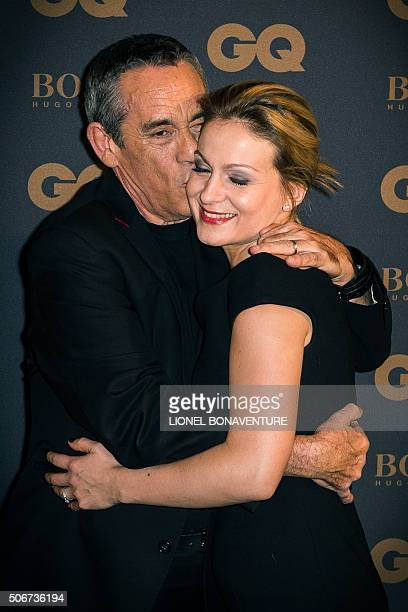 French TV producer Thierry Ardisson kisses his wife French journalist Audrey CrespoMara as they arrive to the 2015 GQ Men of the Year ceremony at the...