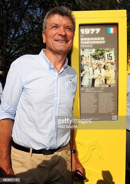 French twotime Tour de France winner Bernard Thévenet poses next to his totem as part of the 'Tour of Giants' a memorial of 101 totems dedicated to...