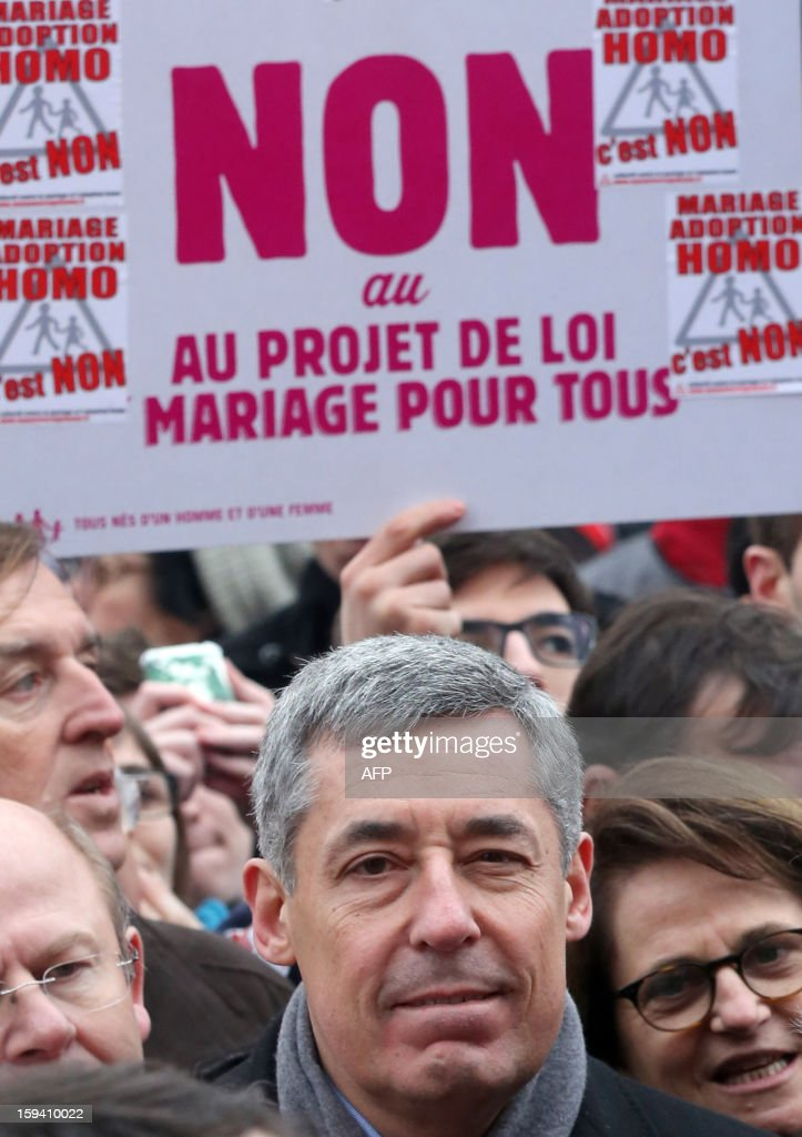 French UMP opposition right-wing party member of parliament Henri Guaino takes part in a protest against same-sex marriage on January 13, 2013 in Paris. Tens of thousands march in Paris on January 13 to denounce government plans to legalise same-sex marriage and adoption which have angered many Catholics and Muslims, France's two main faiths, as well as the right-wing opposition. The French parliament is to debate the bill -- one of the key electoral pledges of Socialist President -- at the end of this month.