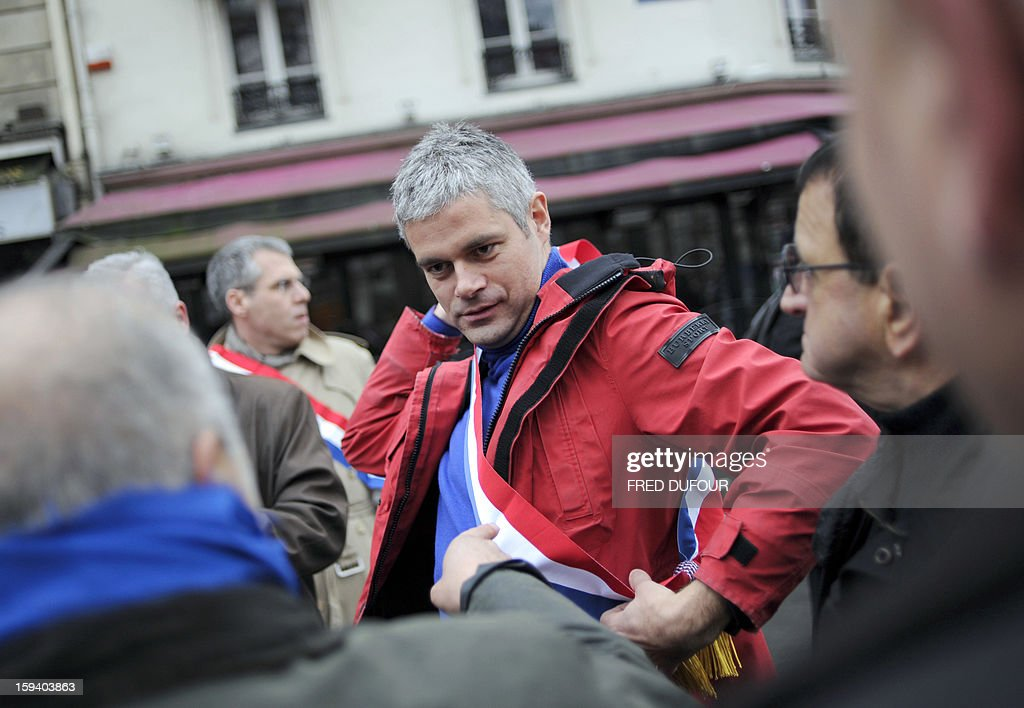 French UMP opposition right-wing party member of parliament Laurent Wauquiez (C) takes part in a march against same-sex marriage on January 13, 2013 in Paris. Tens of thousands march in Paris on January 13 to denounce government plans to legalise same-sex marriage and adoption which have angered many Catholics and Muslims, France's two main faiths, as well as the right-wing opposition. The French parliament is to debate the bill -- one of the key electoral pledges of Socialist President -- at the end of this month.