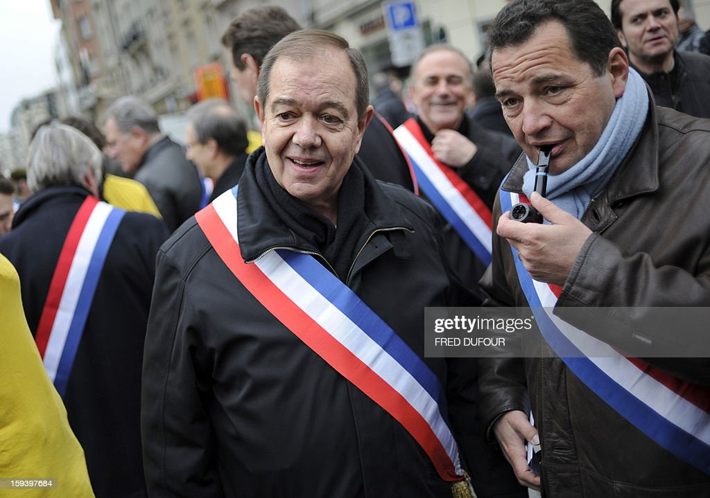 French UMP opposition right-wing party member Patrick Ollier (L) takes part in a march against same-sex marriage on January 13, 2013 in Paris. Tens of thousands march in Paris on January 13 to denounce government plans to legalise same-sex marriage and adoption which have angered many Catholics and Muslims, France's two main faiths, as well as the right-wing opposition. The French parliament is to debate the bill -- one of the key electoral pledges of Socialist President -- at the end of this month.