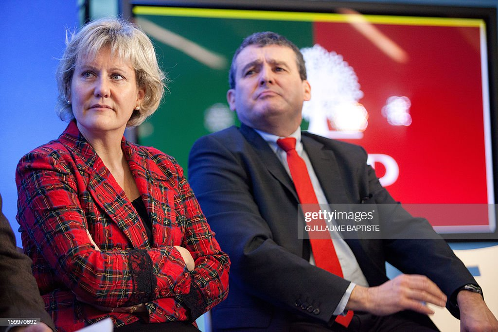 French UMP opposition right-wing party MP Xavier Breton (R) and former minister Nadine Morano listen to speeches, on January 24, 2013 at the party headquarters in Paris, as they take part in a convention focused on family matters.