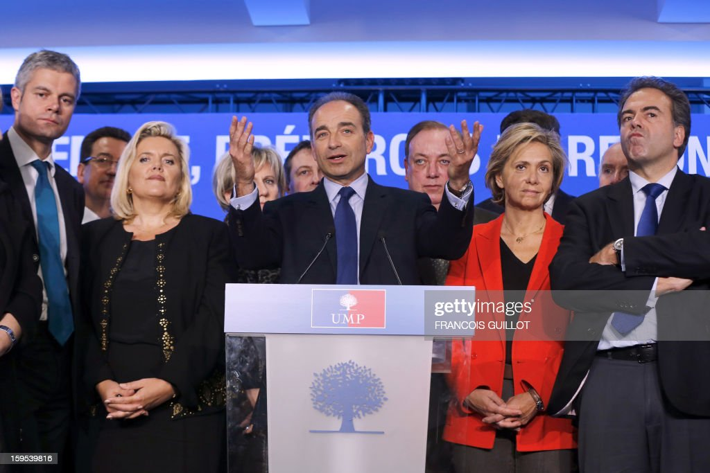 French UMP opposition right-wing party president Jean-Francois Cope (C) gives a press conference with his new team, Laurent Wauquiez (L), UMP vice-president, Michele Tabarot, UMP general secretary, Valerie Pecresse, UMP deputy general secretary and UMP deputy vice-president, Luc Chatel (R) on January 15, 2013, at the UMP headquarters in Paris, to present the party's organisation chart.