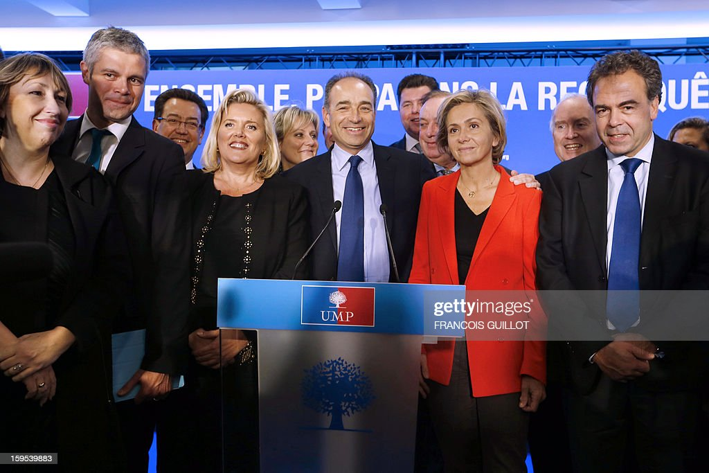 French UMP opposition right-wing party president Jean-Francois Cope (C) gives a press conference with his new team, Laurent Wauquiez (2ndL), UMP vice-president, Michele Tabarot (3rdL), UMP general secretary, Valerie Pecresse (2ndR), UMP deputy general secretary, UMP deputy vice-president, Luc Chatel (R) on January 15, 2013, at the UMP headquarters in Paris, to present the party's organisation chart.