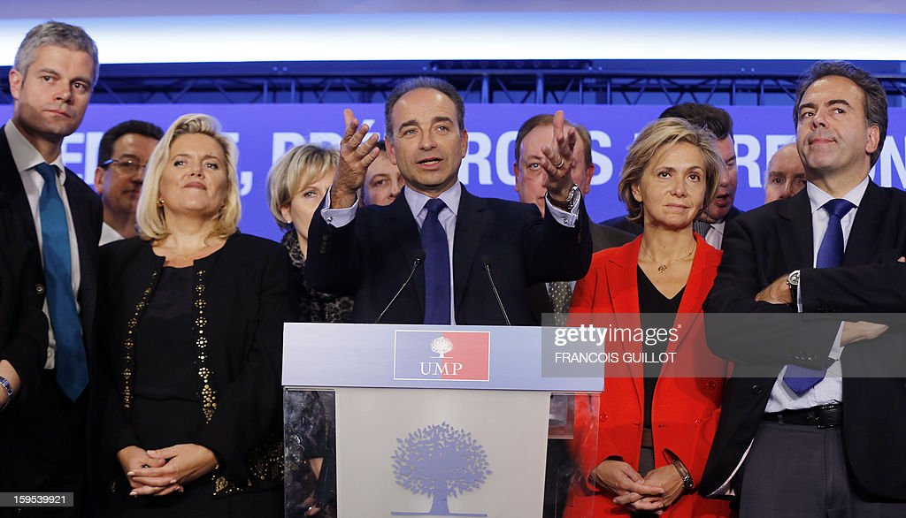 French UMP opposition right-wing party president Jean-Francois Cope (C) gives a press conference with his new team, Laurent Wauquiez (L), UMP vice-president, Michele Tabarot (3ndL), UMP general secretary, Valerie Pecresse (2ndR), UMP deputy general secretary, UMP deputy vice-president, Luc Chatel (R) on January 15, 2013, at the UMP headquarters in Paris, to present the party's organisation chart.