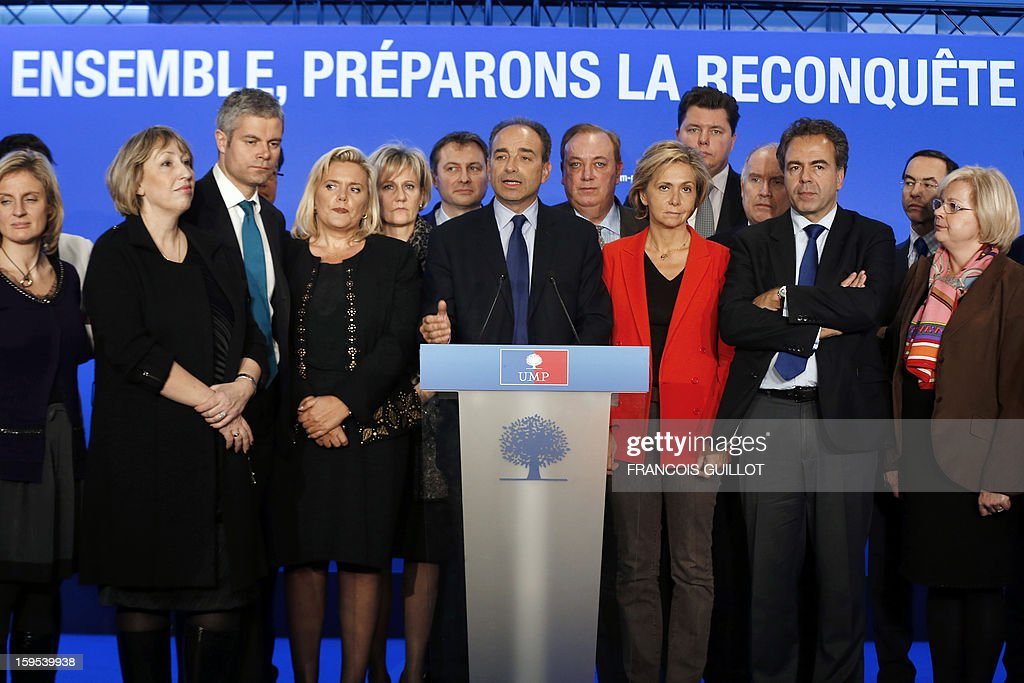 French UMP opposition right-wing party president Jean-Francois Cope (C) gives a press conference with his new team, Laurent Wauquiez (3rdL), UMP vice-president, Michele Tabarot (4thL), UMP general secretary, Valerie Pecresse (3rdR), UMP deputy general secretary, UMP deputy vice-president, Luc Chatel (2ndR) on January 15, 2013, at the UMP headquarters in Paris, to present the party's organisation chart.