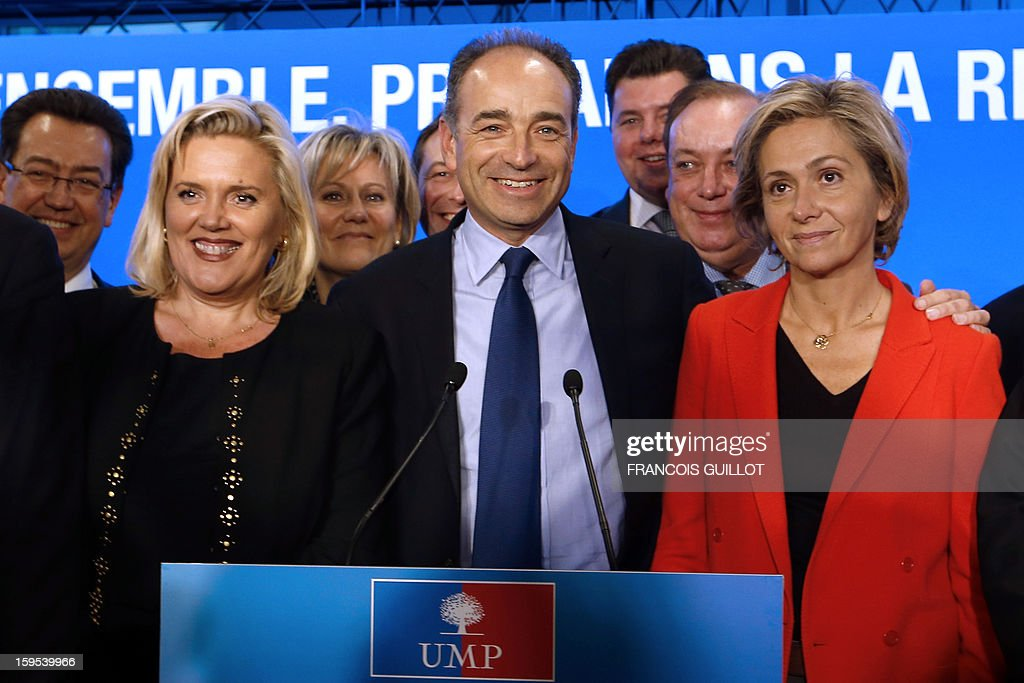French UMP opposition right-wing party president Jean-Francois Cope (C) gives a press conference with his new team, Michele Tabarot (L), UMP general secretary, Valerie Pecresse (R) and UMP deputy general secretary, on January 15, 2013, at the UMP headquarters in Paris, to present the party's organisation chart. AFP PHOTO FRANCOIS GUILLOT