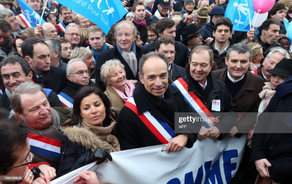 French UMP opposition right-wing party president Jean-Francois Cope (3rdL) and his wife Nadia Hamama (2ndL), UMP member of parliament Patrick Ollier (2ndR) take part in a protest against same-sex marriage on January 13, 2013 in Paris. Tens of thousands march in Paris on January 13 to denounce government plans to legalise same-sex marriage and adoption which have angered many Catholics and Muslims, France's two main faiths, as well as the right-wing opposition. The French parliament is to debate the bill -- one of the key electoral pledges of Socialist President -- at the end of this month.