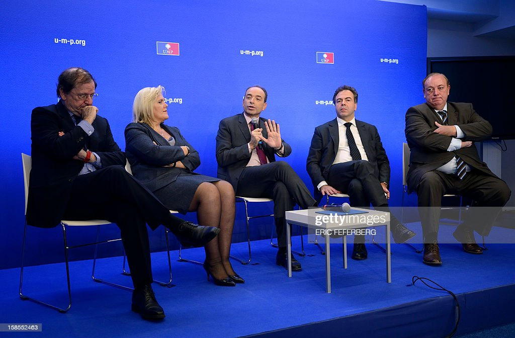 French UMP opposition right-wing party President Jean-Francois Cope (C) flanked by UMP staff members (LtoR) Herve Novelli, Michele Tabarot, Luc Chatel and Marc-Philippe Daubresse, gives a press conference after a meeting of the political committee, at the UMP headquarters on December 19, 2012 in Paris. Cope and Francois Fillon, the rivals in the leadership row which split French former ruling party, the UMP, agreed on December 17, 2012 to a new internal election after a bitterly-contested first vote last month.