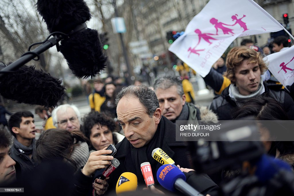 French UMP opposition right-wing party president Jean-Francois Cope speaks to journalists as he takes part in a march against same-sex marriage on January 13, 2013 in Paris. Tens of thousands march in Paris on January 13 to denounce government plans to legalise same-sex marriage and adoption which have angered many Catholics and Muslims, France's two main faiths, as well as the right-wing opposition. The French parliament is to debate the bill -- one of the key electoral pledges of Socialist President -- at the end of this month.