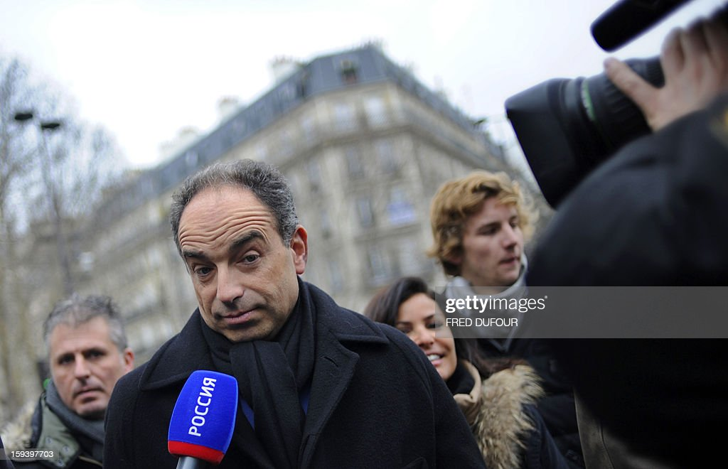 French UMP opposition right-wing party president Jean-Francois Cope speaks to journalists as he takes part in a march against same-sex marriage on January 13, 2013 in Paris. Tens of thousands march in Paris on January 13 to denounce government plans to legalise same-sex marriage and adoption which have angered many Catholics and Muslims, France's two main faiths, as well as the right-wing opposition. The French parliament is to debate the bill -- one of the key electoral pledges of Socialist President -- at the end of this month. AFP PHOTO / FRED DUFOUR