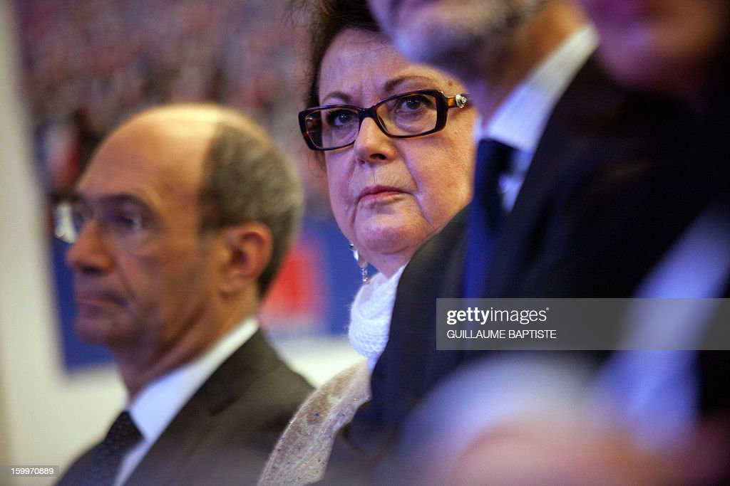 French UMP opposition right-wing party's former Minister Eric Woerth (L) and leader of France's Christian Democratic party Christine Boutin (R) listen to speeches, on January 24, 2013 at the party headquarters in Paris, during a convention focused on family matters. AFP PHOTO GUILLAUME BAPTISTE