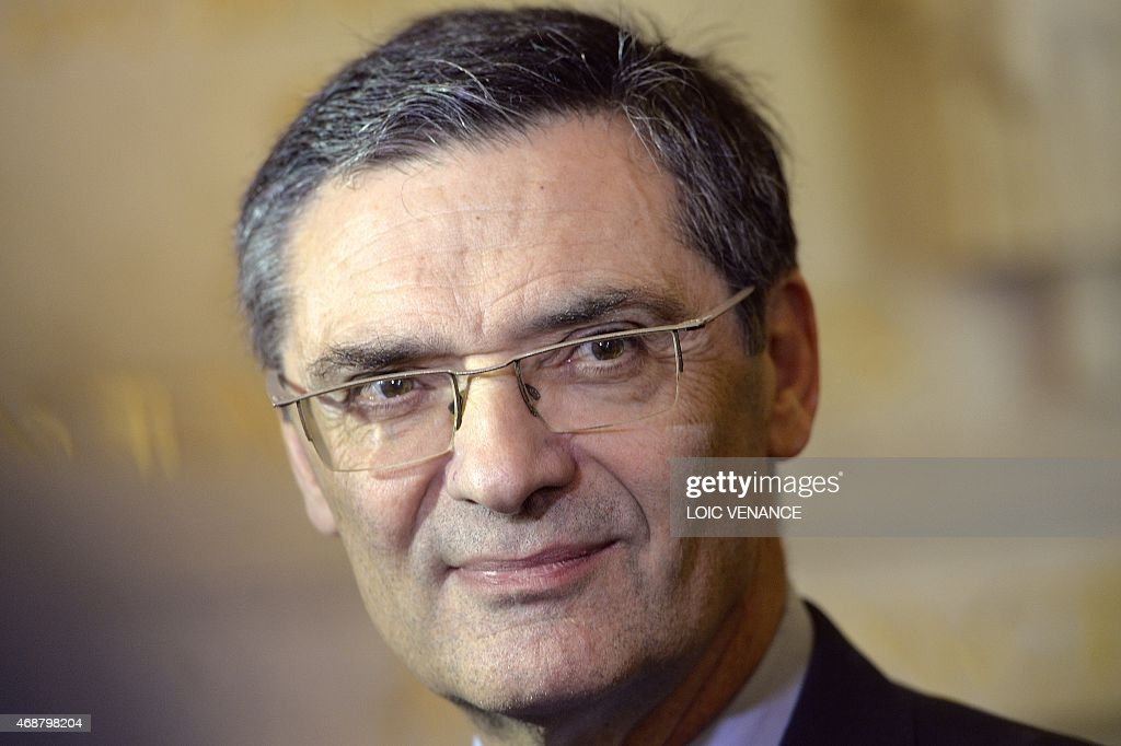 French UMP right-wing opposition party member of Parliament <a gi-track='captionPersonalityLinkClicked' href=/galleries/search?phrase=Patrick+Devedjian&family=editorial&specificpeople=779301 ng-click='$event.stopPropagation()'>Patrick Devedjian</a> answers journalists prior to a session of Questions to the Government on April 7, 2015 at the French National Assembly in Paris.