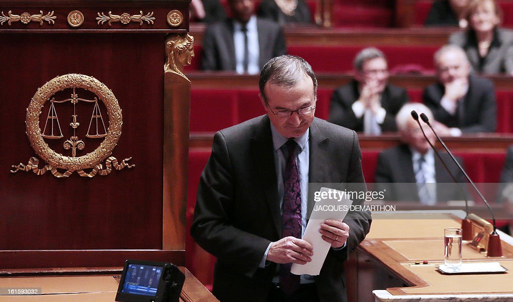 French UMP right-wing opposition party MP Herve Mariton leaves after a speech explaining the vote by the right-wing group on February 12, 2013 at the French National Assembly in Paris, after the assembly voted by a clear majority to adopt legislation allowing homosexual couples to marry and adopt children. The formal vote came 10 days after lawmakers voted overwhelmingly in favour of its key article which redefines marriage as a contract between two people rather than between a man and a woman. The law will now go for approval by the upper house of parliament.