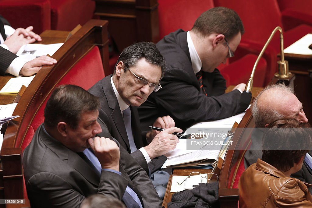 French UMP right-wing party former minister Patrick Devedjian (C) attends the weekly session of questions to the government on December 19, 2012 at the National Assembly in Paris.