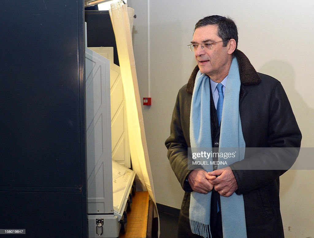 French UMP right-wing party former minister Patrick Devedjian, candidate for his reelection as member of Parliament, in the Hauts-de-Seine 13th constituency, prepares to vote in a polling station, in Antony, a Paris southern suburb, on December 9, 2012. French Conseil Constitutionnel, one of the country's highest courts, cancelled his precedent election because his substitute was also the one for a senator, which is illegal. MEDINA