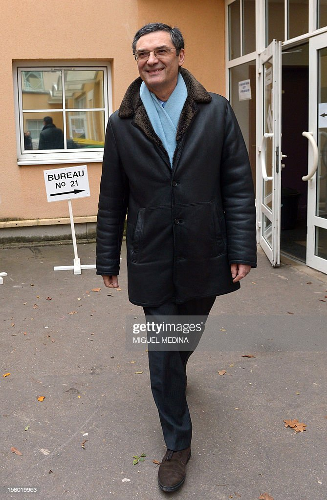 French UMP right-wing party former minister Patrick Devedjian, candidate for his reelection as member of Parliament, in the Hauts-de-Seine 13th constituency, leaves after voting in a polling station, in Antony, a Paris southern suburb, on December 9, 2012. French Conseil Constitutionnel, one of the country's highest courts, cancelled his precedent election because his substitute was also the one for a senator, which is illegal. MEDINA