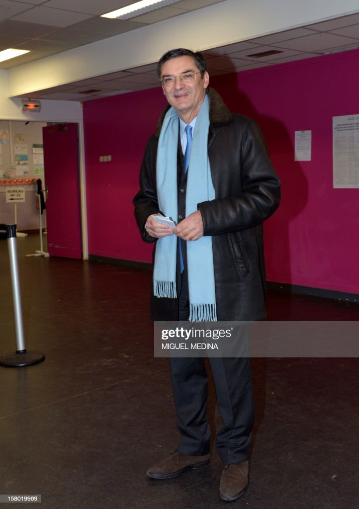 French UMP right-wing party former minister Patrick Devedjian, candidate for his reelection as member of Parliament, in the Hauts-de-Seine 13th constituency, poses before voting in a polling station, in Antony, a Paris southern suburb, on December 9, 2012. French Conseil Constitutionnel, one of the country's highest courts, cancelled his precedent election because his substitute was also the one for a senator, which is illegal. MEDINA