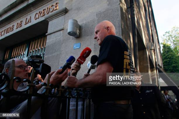 French union CGT member Patrick Brun speaks to the press following the first interuption of the meeting with members of GMS interunion managers of...