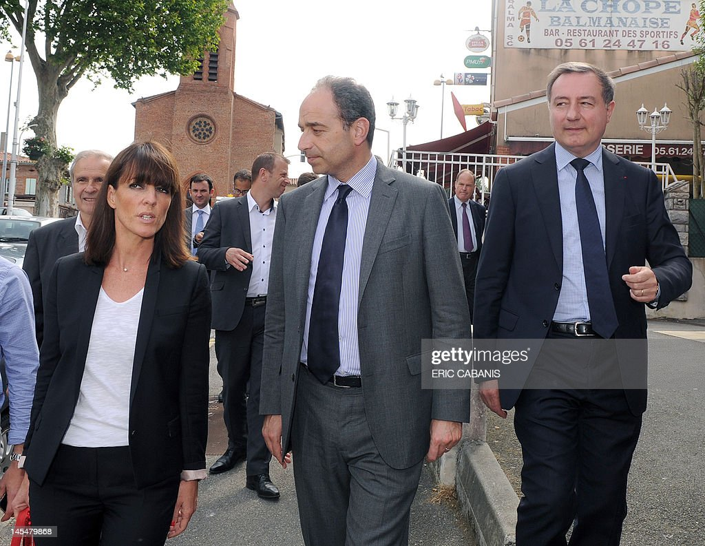 French Union for a Popular Movement (UMP) right-wing party's general secretary, Jean-Francois Cope (C), walks beside former Toulouse's mayor Jean-Luc Moudenc, candidate for June 2012 French parlamentiary election in the Haute-Garonne's 3th constituency, and Moudenc's substitute Laurence Arribage during a campaign visit on May 31, 2012 in Balma, southwestern France.