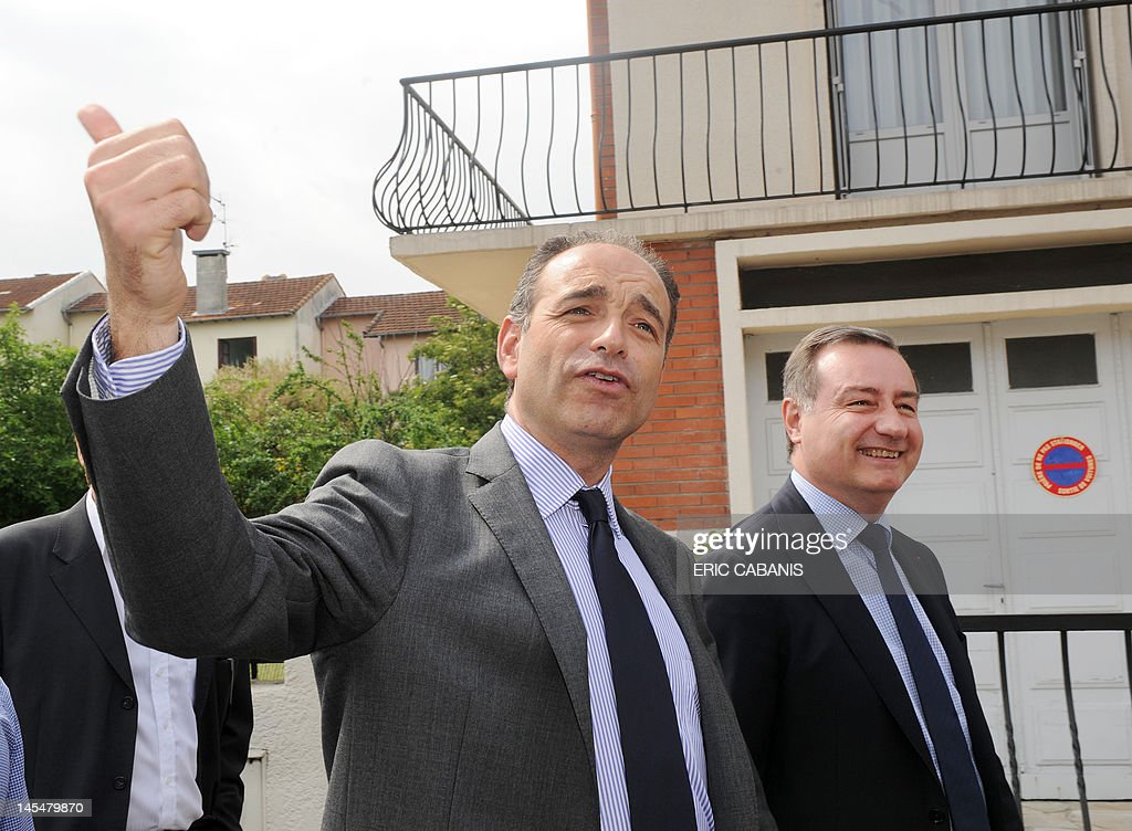 French Union for a Popular Movement (UMP) right-wing party's general secretary, Jean-Francois Cope (C), walks beside former Toulouse's mayor Jean-Luc Moudenc (R), candidate for June 2012 French parlamentiary election in the Haute-Garonne's 3th constituency, during a campaign visit on May 31, 2012 in Balma, southwestern France.