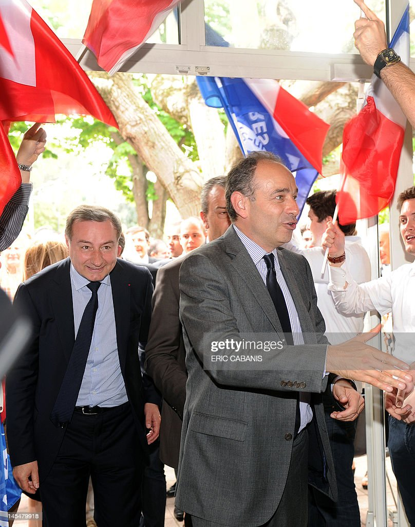 French Union for a Popular Movement (UMP) right-wing party's general secretary, Jean-Francois Cope (C) arrives for a meeting in support of Jean-Luc Moudenc (L), UMP right-wing ruling party candidate for the June 2012 French parliamentary election in the 3rd constituency of Haute-Garonne department, on May 31, 2012 in Balma, southwestern France.