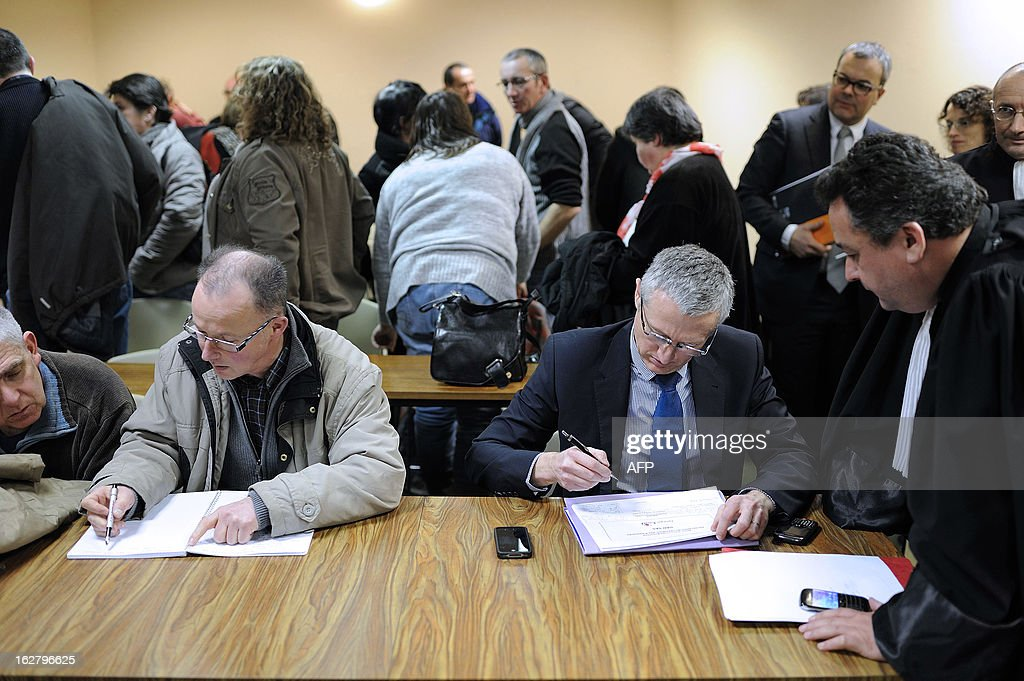 French unions representative of the Gad SAS agribusiness company's pig-slaughterhouse, Patrick Piguel (L), and Gad SAS General Director Christophe Peter (R) attend an audience at the trade tribunal on February 27, 2013 in Rennes, western France, some days after the voluntary liquidation by the group. Gad SAS which employs 1,700 workers in two sites, Josselin and Lampaul-Guimiliau, lost 20 million euros (26,15 million US dollars) in 2012.
