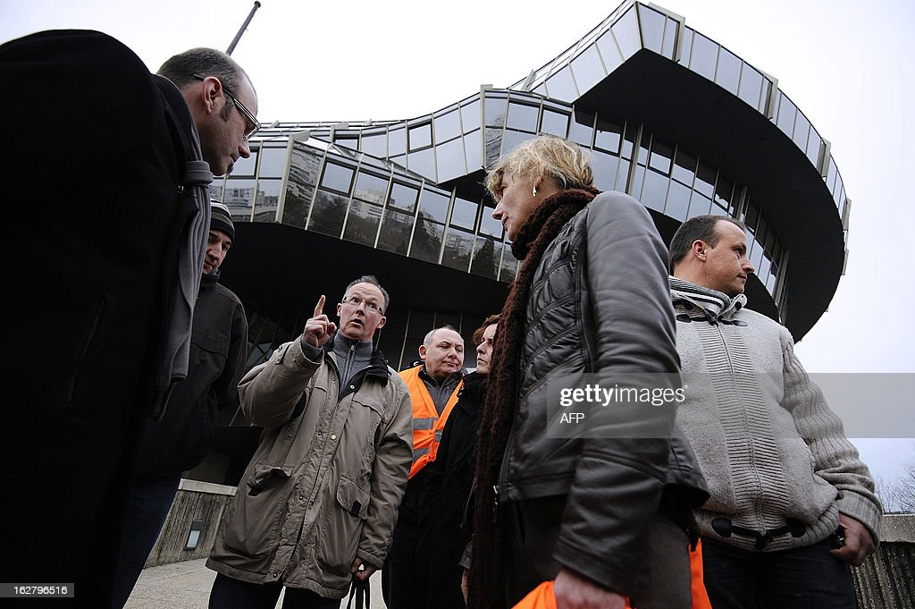 French unions representatives of the pig-slaughterhouse of the Gad SAS agribusiness company speak in front of the trade tribunal on February 27, 2013 in Rennes, western France, some days after the voluntary liquidation by the group. Gad SAS which employs 1,700 workers in two sites, Josselin and Lampaul-Guimiliau, lost 20 million euros (26,15 million US dollars) in 2012. AFP PHOTO JEAN-SEBASTIEN EVRARD