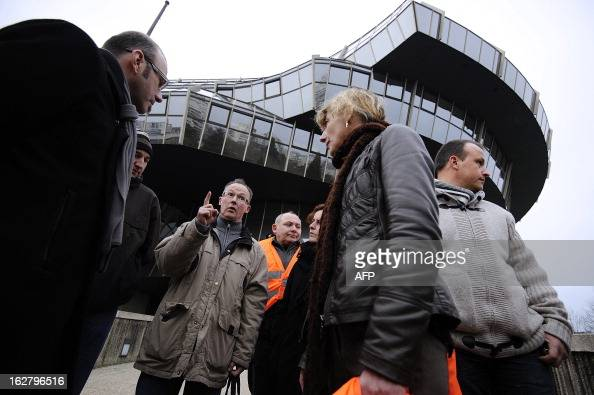 French unions representatives of the pigslaughterhouse of the Gad SAS agribusiness company speak in front of the trade tribunal on February 27 2013...