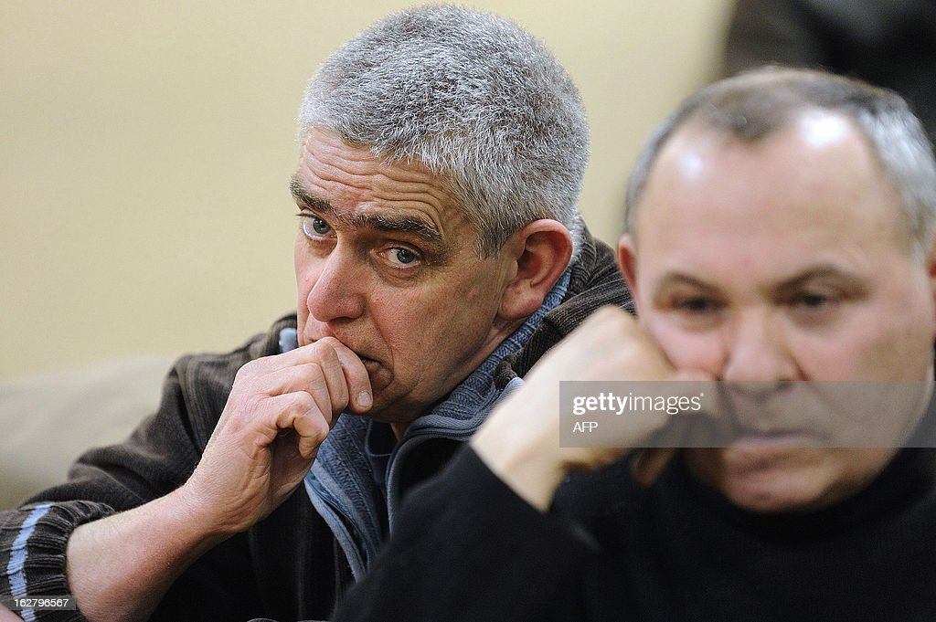 French unions representatives of the pig-slaughterhouse of the Gad SAS agribusiness company reacts during an audience at the trade tribunal on February 27, 2013 in Rennes, western France, some days after the voluntary liquidation by the group. Gad SAS which employs 1,700 workers in two sites, Josselin and Lampaul-Guimiliau, lost 20 million euros (26,15 million US dollars) in 2012. AFP PHOTO JEAN-SEBASTIEN EVRARD