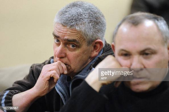 French unions representatives of the pigslaughterhouse of the Gad SAS agribusiness company reacts during an audience at the trade tribunal on...