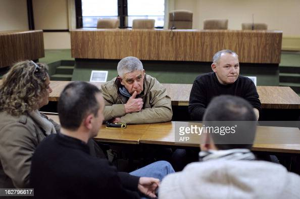 French unions representatives of the pigslaughterhouse of the Gad SAS agribusiness company wait during an audience at the trade tribunal on February...