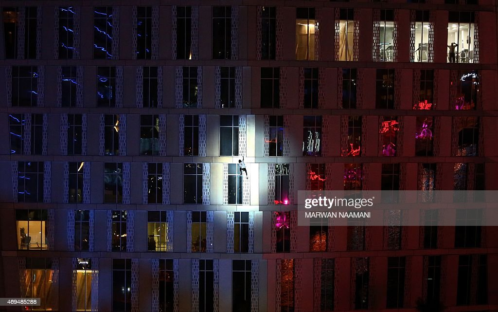 French urban climber <a gi-track='captionPersonalityLinkClicked' href=/galleries/search?phrase=Alain+Robert+-+Climber&family=editorial&specificpeople=769748 ng-click='$event.stopPropagation()'>Alain Robert</a>, also known as 'Spider-Man', scales the Cayan Tower, the world's tallest twisted building, on April 12, 2015 in Dubai.