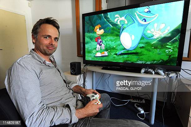 CHERIFIA French videogame designer for Ubisoft company Michel Ancel poses with one of the videogames the studio created 'Rayman' at the Ubisoft...