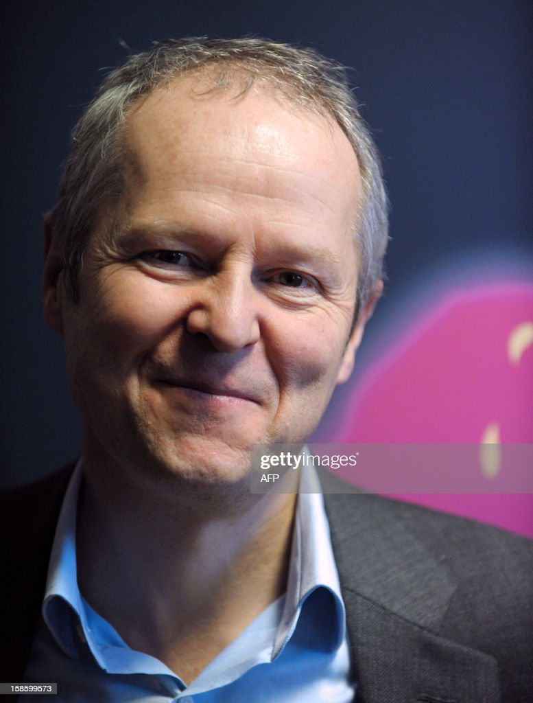 French videogame firm Ubisoft CEO, Yves Guillemot poses prior to a visit by French Junior Minister for SMEs, Innovations and Digital Economy, at Ubisoft's development studio on December 20, 2012 in Montreuil, a Paris' suburb. AFP PHOTO / ERIC PIERMONT