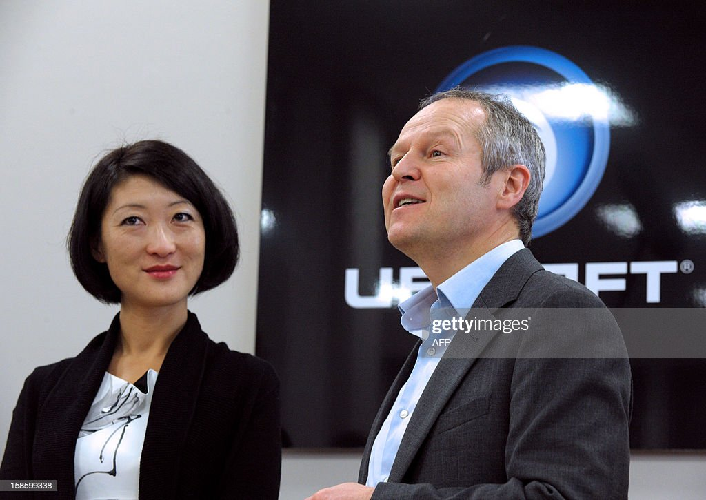 French videogame firm Ubisoft CEO, Yves Guillemot (R) talks beside French Junior Minister for SMEs, Innovations and Digital Economy, Fleur Pellerin during her visit to Ubisoft's development studio on December 20, 2012 in Montreuil, a Paris' suburb.