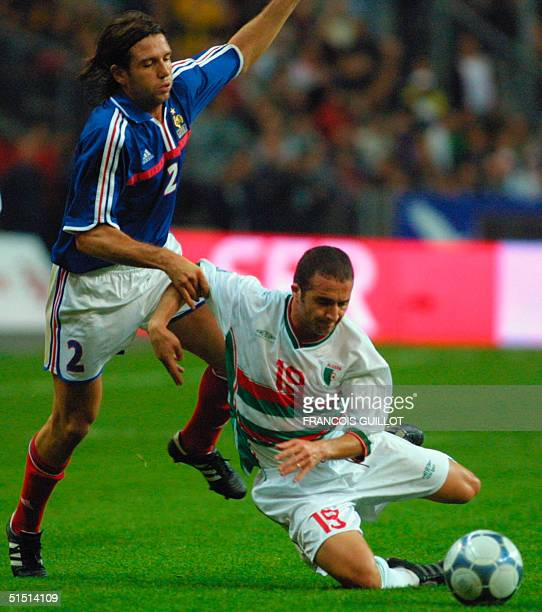 French Vincent Candela tries to dribble past Algerian Djamel Belmadi during the friendly soccer match France vs Algeria at the Stade de France in...
