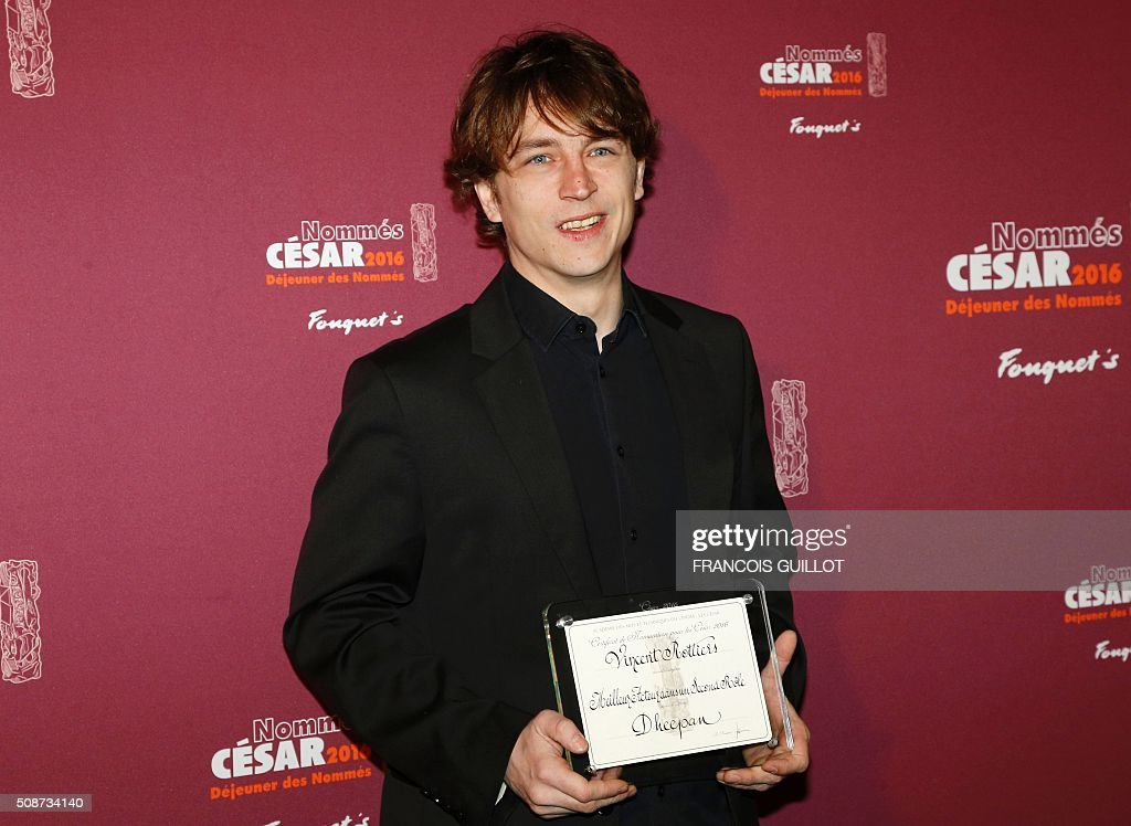 French Vincent Rottiers poses with his nomination certificate for Best Actor in a Supporting Role (Dheepan) during the nominations event for the 2016 César film awards, on February 6, 2016 in Paris. The 41st Ceremony for the Cesar film award, considered as the highest film honour in France, will take place on February 26, 2016. / AFP / FRANCOIS GUILLOT